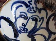 Monk in cobalt on porcelain bowl.
