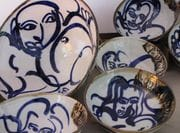 Large Serving Bowl with set of figurative line drawing bowls, in cobalt.