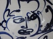 Detail from 3 faces bowl.