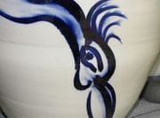 Detail of bird painting in cobalt on large jar.
