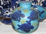 Turquoise screw top jar.