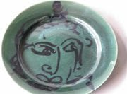 Face in cobalt with Green glaze.