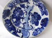 Hibiscus tree cobalt on white dinner plate.