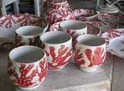 Group of red coral tea bowls/wine cups.
