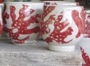Red coral tea bowls.
