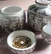 Jars in Ivory glaze with iron detail.