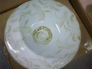 Subtle crane design plate in Ivory glaze.