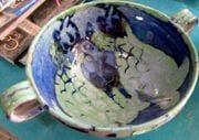 Turtles swimming soup bowl.