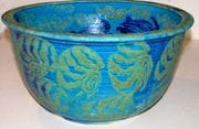 Turquoise water bowl with cobalt swimming turtles.