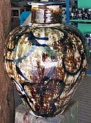 Large blossom jar with figure/face.