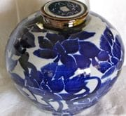Blue and white ginger jar with screw top lid.