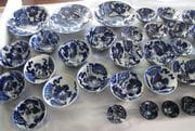 A selection of bowls with cobalt hibiscus design.