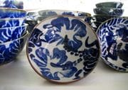 White stoneware bowls with cobalt design.