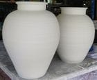 Large jars in the studio. Greenware.
