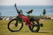 Dogg's innovative use of the Rotacaster omniwheel allows riders to perform stunts with confidence. The Dogg bike is now being sold by Momentum Bikes as the Mono Bike in Kmart, Big W, Toys R Us and Toyworld stores throughout Australia