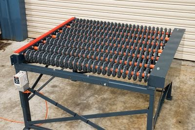 Power driven feed table using Rotacaster 125mm wheels