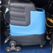 Rotacaster Stair Climbing wheels fitted to an industrial carpet cleaning machine.