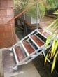 Rotacaster 125mm wheel being used on an articulating staircase between a house boat and jetty. Rotacaster wheels are made from all polymer materials making them ideal for salt water and marine environments.