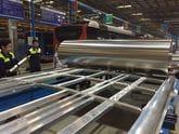 Fixtech Fix190 bonding Aluminium frame to Aluminium sheet for a bus roof.